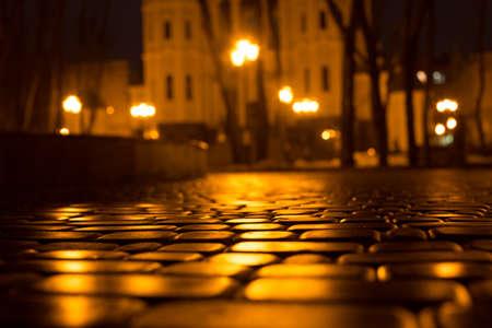 Wet cobblestone street at night. Kharkov. Ukraine