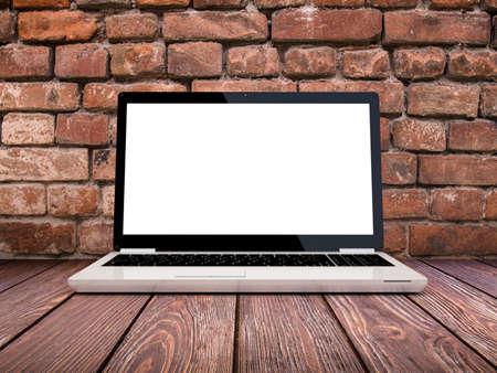 briks: Laptop computer on bricks and wood background