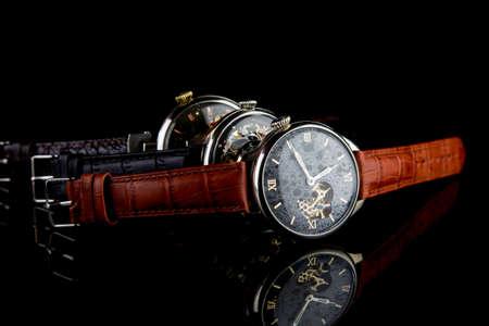 Man's watch on black background. Luxury goods.