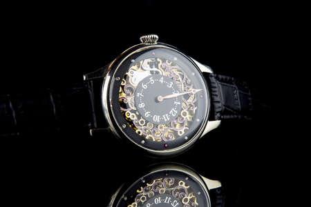mans watch: Mans watch on black background. Luxury goods.