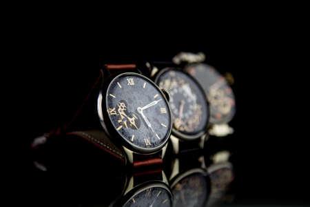 luxury goods: Mans watch on black background. Luxury goods.
