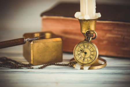 Pocket watch and candle