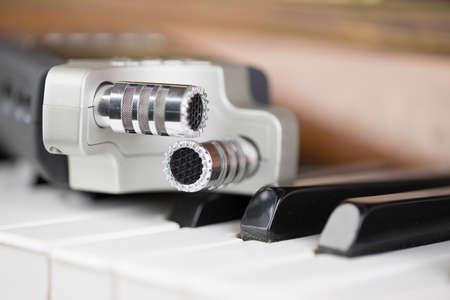 Microphone on piano keys Stock Photo