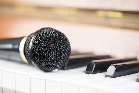 Microphone on piano keys Stock Photo