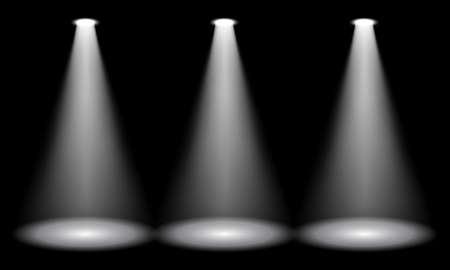 Spotlight on stage. Volume light on a black background. Vector illustration Vettoriali