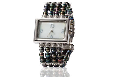 human wrist: woman watch  from pearl on white
