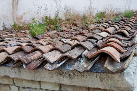 Old tiled roof with grass