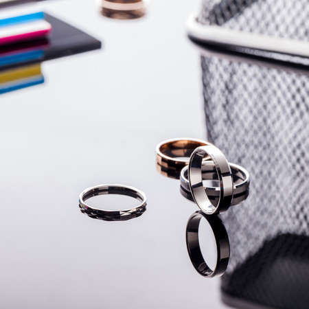 Group of beautiful jewelry rings on a table with reflection and with a fashionable background 写真素材