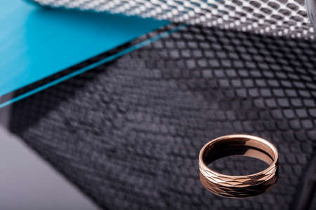 Gold ring with facets isolated on black background. Fashion jewelry.