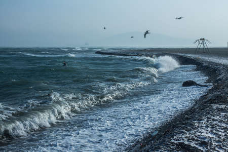 view from the beach to the raging winter sea