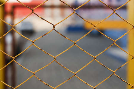 chainlink fence: Yellow chain-link fencing. Stock Photo