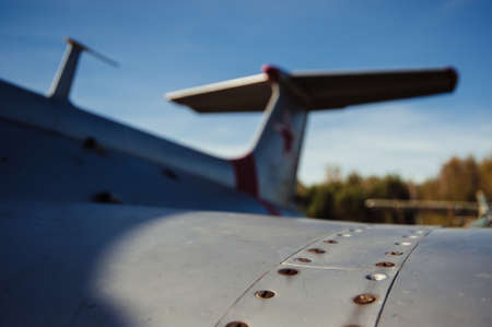 Wing of old airplane. Scratched fuselage. Rusty bolts.