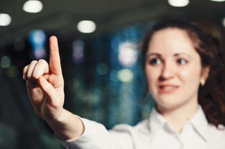 Business woman gesturing with hands in office close-up. Classic business.  Interactive touch panel. Stock Photo