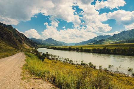 The Katun River flows among the mountains and hills. Picturesque landscape of Altai nature.