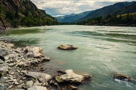 rages: Turquoise raging Katun. Milk river. Mountain Altai. Stock Photo