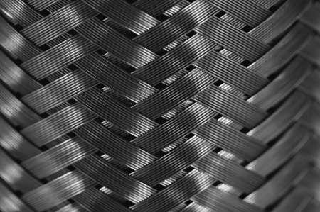 Vertical metal wire braiding. Steel texture. Background. Template.