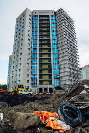 The process of construction of a modern multi-storey residential building. Editorial