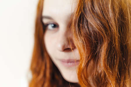 Beautiful, healthy, long, curly, red hair dyed with henna. Professional hair care. Banque d'images