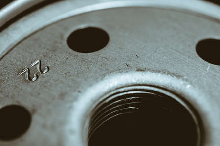 Monochrome background image of oil filter close up. Art macro photography of auto part. Stock Photo