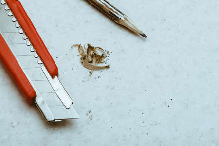 Table composition with pencil, cleric knife and shavings. Copy space. Standard-Bild