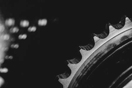 Monochrome background image of gear close up. Artwork from auto part in macro photography. Stock fotó