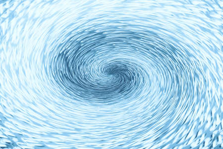 Blue wormhole in form of spiral absorbs space. Background image of asymmetric vortex tunnel in center of shot.