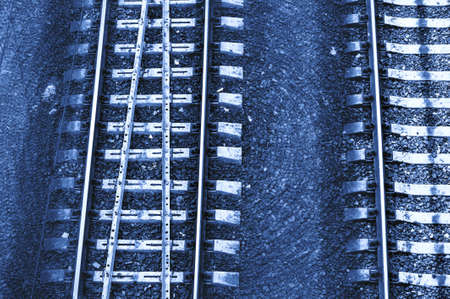 Speed and vertigo on railroad in blue tones. Railway abstract monochrome background with copy space.