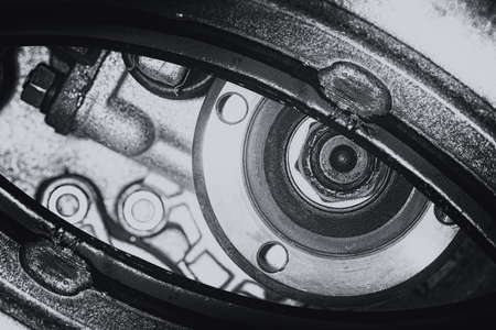 Unusual robotic eye in steampunk style in grayscale. Focused robot look. Monochrome background pattern close-up. Banque d'images