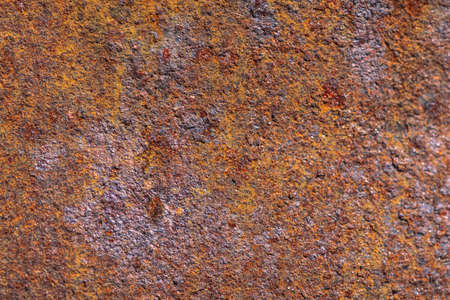 Rust on metallic surface. Rusted iron texture. Rusty metal background with copy space. Rough oxide plate close up. Strong rust. Hard decay of metal in macro. Oxidation of steel. Chemical reaction.