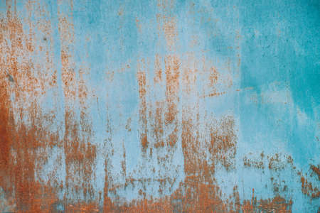 Rust on metallic surface. Iron texture. Partly rusty background. Rough oxide plate close-up. Hard decay of metal. Oxidation of steel. Chemical reaction. Partially rusted metal panel with peeling paint
