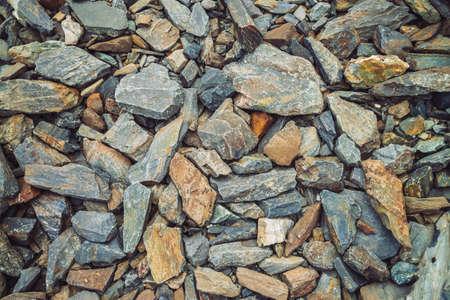 Multicolored boulder stream. Loose rock close up. Randomly scattered stones in nature. Amazing detailed background of highlands boulders with mosses and lichens. Natural texture of mountain terrain. Imagens