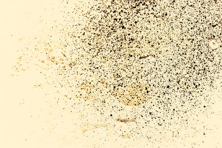 Vintage yellow background. Rough painted wall of aspen gold color. Imperfect plane of golden colored. Uneven old decorative toned backdrop of yellow tint. Texture of gold hue. Ornamental stony surface Фото со стока