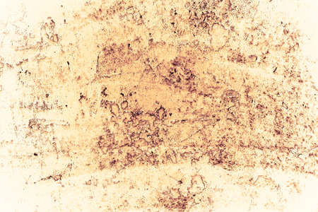 Vintage yellow background. Rough painted wall of aspen gold color. Imperfect plane of golden colored. Uneven old decorative toned backdrop of yellow tint. Texture of gold hue. Ornamental stony surface Фото со стока - 147578577