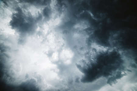 Dramatic cloudscape texture. Dark heavy thunderstorm clouds before rain. Overcast rainy bad weather. Storm warning. Natural gray background of cumulonimbus. Nature backdrop of stormy cloudy sky.