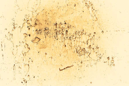 Vintage yellow background. Rough painted wall of aspen gold color. Imperfect plane of golden colored. Uneven old decorative toned backdrop of yellow tint. Texture of gold hue. Ornamental stony surface