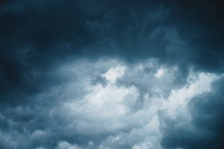 Dramatic cloudscape texture. Dark heavy thunderstorm clouds before rain. Overcast rainy bad weather. Storm warning. Natural blue background of cumulonimbus. Nature backdrop of stormy cloudy sky.