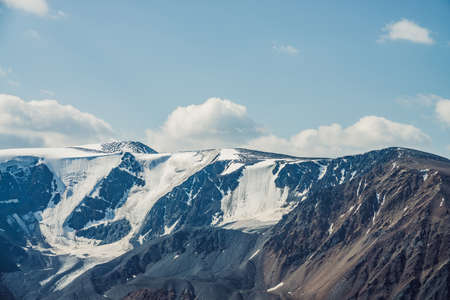 Atmospheric alpine view to big snowy mountains with glaciers. Scenic highland landscape with giant mountains with snow on tops. Awesome scenery of majestic nature. Snow on great rocks on high altitude 스톡 콘텐츠