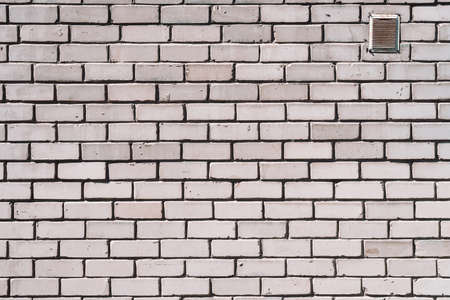Old realistic brick wall made of white brick. White uneven brickwork.