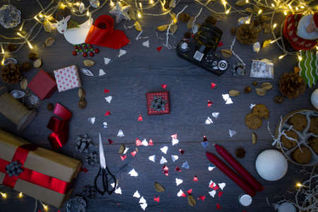 Rustic wooden table with christmas decorations, high angle overhead view