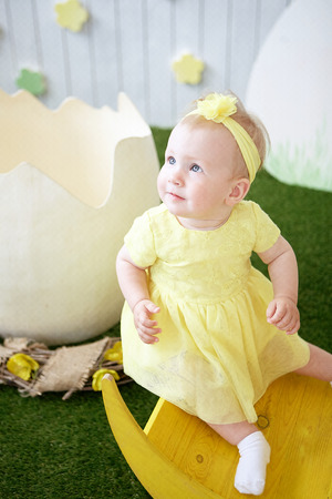 Portrait of adorable little girl in yellow dress