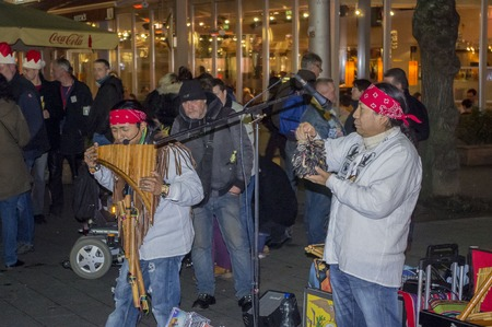 busker: Germany, Kassel- December 23, 2015; Unidentified Man playing pan pipes.