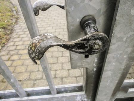 metal grate: Lock and metal door handle in closed Park gates, Germany Stock Photo