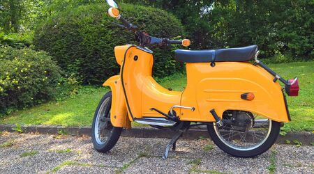 An old yellow motor scooter.