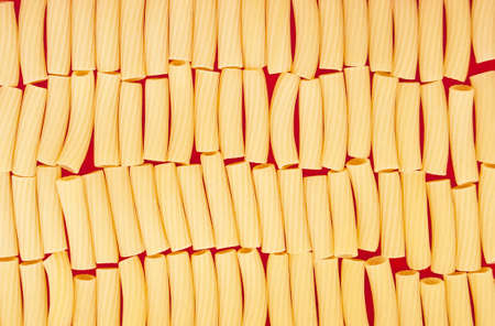 texture of italian pasta on red background photo