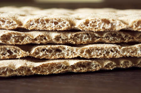 three brown cracker over wood background, diet photo