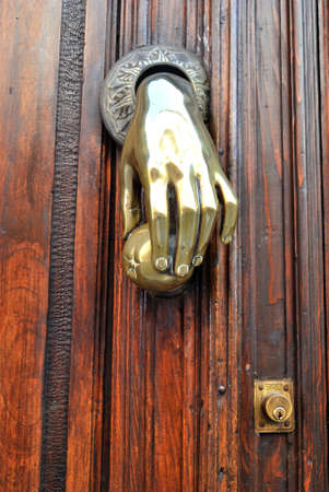 Brass knocker in a old door  photo