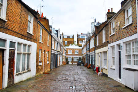 describing: LONDON - JANUARY 24: Mews is a primarily British term formerly describing a row of stables, usually with carriage houses below and living quarters above. January, 24, 2016 in London, England.