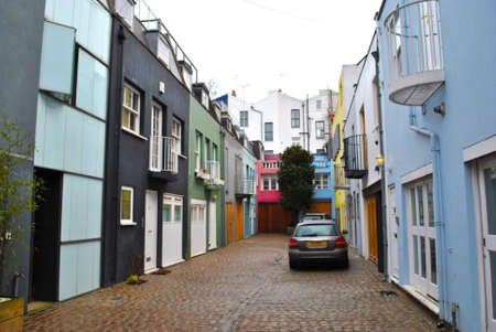 primarily: Mews is a primarily British term formerly describing a row of stables, usually with carriage houses below and living quarters above