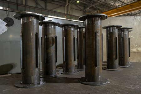 Welding seam onto steel sheet metal industrial steel welder in factory.  Banco de Imagens