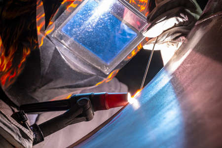 Welding of stainless steel by electric arc welding in argon shielding gas. TIG welding.